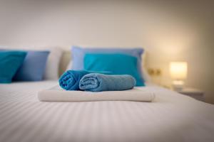 Postel nebo postele na pokoji v ubytování Studio Goga