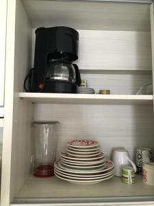 Coffee and tea-making facilities at Apartamento Tambaú