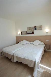 A bed or beds in a room at Casa de los Beneficiados