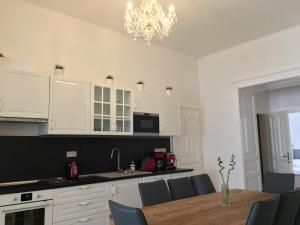 A kitchen or kitchenette at Masna 19 Old Town Apartment