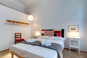 A bed or beds in a room at Route26 - Florence