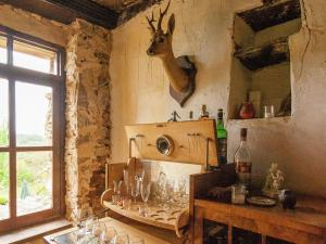 A kitchen or kitchenette at Cozy Cottage in Aquitaine with Fireplace