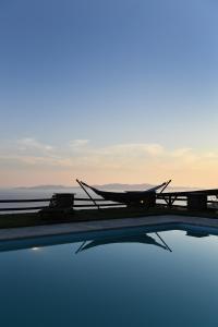The swimming pool at or near Tinos Sky View Villa