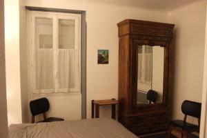 Un ou plusieurs lits dans un hébergement de l'établissement Un Petit Coin De Paradis