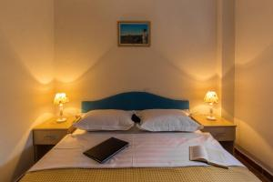 A bed or beds in a room at Blue Mediterranean Apartments