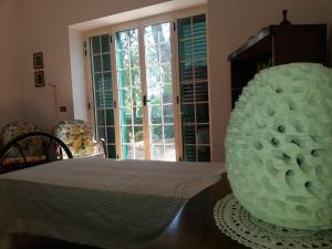 Ein Bett oder Betten in einem Zimmer der Unterkunft Casa Vacanze Villa Martino