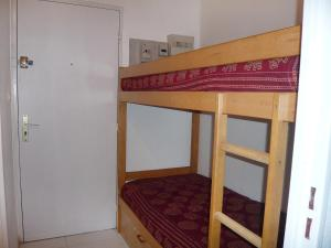 A bunk bed or bunk beds in a room at Apartment Les Aigues Marines.36