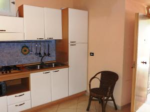 A kitchen or kitchenette at Locazione turistica De Gasperis