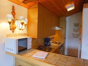 Küche/Küchenzeile in der Unterkunft Apartment Les Arsets.18