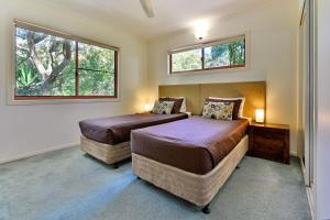 A bed or beds in a room at Heliconia Grove 9