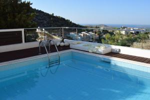 The swimming pool at or close to Panorama Penthouse & Studios