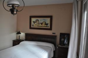 Ein Bett oder Betten in einem Zimmer der Unterkunft Casa del Laurel