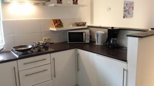 A kitchen or kitchenette at Trendy New Loft