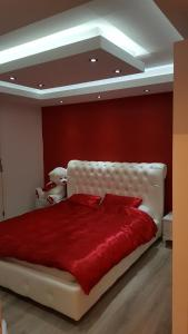A bed or beds in a room at Vujovic Apartment