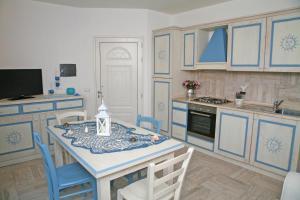 A kitchen or kitchenette at Sogno di Rena