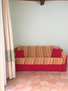 A seating area at Appartamenti Bosa