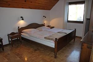 Un ou plusieurs lits dans un hébergement de l'établissement Farmhouse Soklic