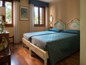 Cama ou camas em um quarto em Rialto