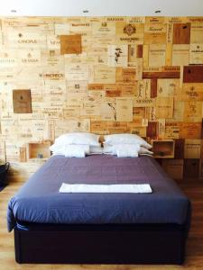A bed or beds in a room at Residences Wine