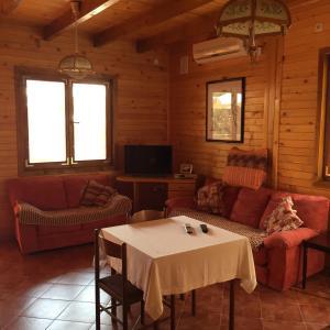 Prostor za sedenje u objektu Apartments Guci