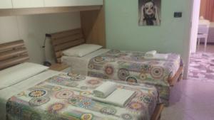 Letto o letti in una camera di Casa Marina