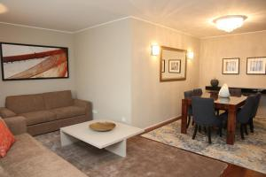 A seating area at LoftAbroad Premium Apartments
