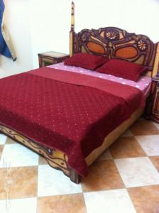 A bed or beds in a room at Luxury Apartment Taif