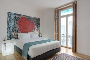 A bed or beds in a room at Chiado Arty Flats
