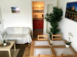 Lounge nebo bar v ubytování Arcaden Apartment