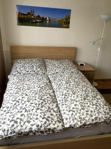 Postel nebo postele na pokoji v ubytování Arcaden Apartment