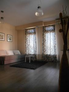 Prostor za sedenje u objektu Top Apartment
