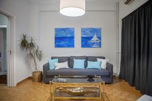 A seating area at Lav Athens Apts