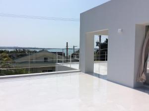 A balcony or terrace at Seaside House Nirai
