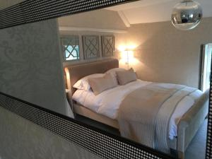 A bed or beds in a room at The Old Rectory Mews