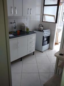 A kitchen or kitchenette at Balneário Camboriú 3200