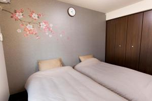 A bed or beds in a room at Kyostay Iroha Toji Annex