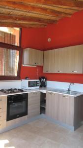 A kitchen or kitchenette at Tiria Is Molas