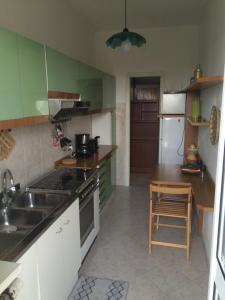 A kitchen or kitchenette at Casa Carozzi - Carozzi Apartments