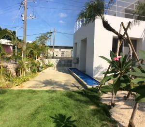 A garden outside Seaside House Nirai
