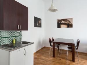 A kitchen or kitchenette at Apartment Krakow Zegadłowicza