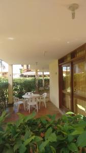 A porch or other outdoor area at Apartamento de 3 quartos a 200m da praia