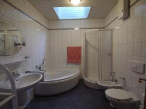 Ein Badezimmer in der Unterkunft Ferienhaus Reuter