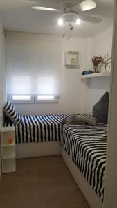 A bed or beds in a room at Apartamento Oxford