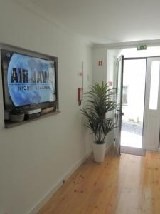 A television and/or entertainment center at Alfama Warehouse 2
