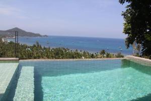 The swimming pool at or near Anankhira Villas