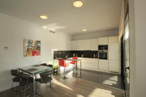 A kitchen or kitchenette at Villa La Marina