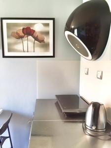 Télévision ou salle de divertissement dans l'établissement Apartment Na Hrebenkach