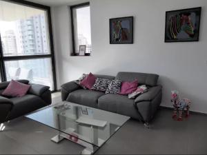 A seating area at Ir Yamin - 3 Bed Sea-View Apartment