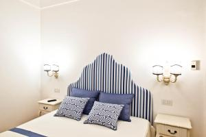 Casa Cinque tesisinde bir odada yatak veya yataklar