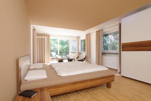 Ein Bett oder Betten in einem Zimmer der Unterkunft Ein Traum direkt am See